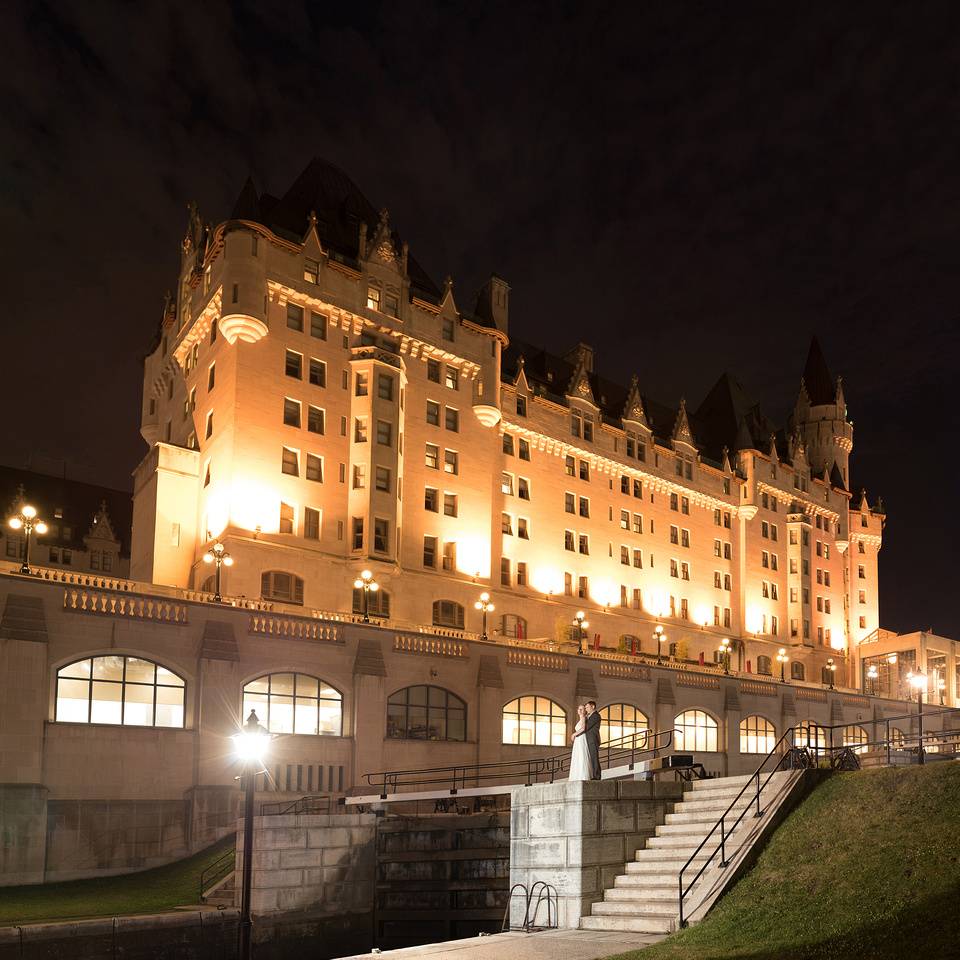 Chateau Laurier at night wedding couple above the Rideau Canal